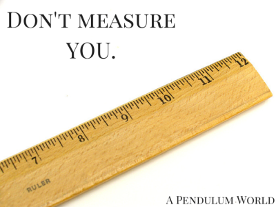 "Title ""Don't measure YOU"" next to wooden ruler."