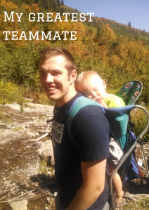 Sam hiking with Parker on his back, asleep in a baby carrier.